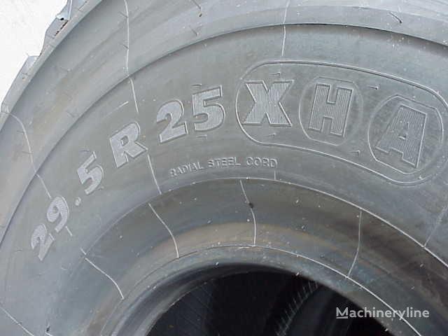 нова гума за челен товарач Michelin 29.50- 25.00